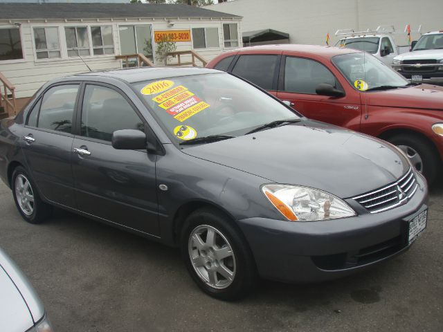 2006 MITSUBISHI LANCER ES gray this 06 mits lancer is in excellent running condition engine is me