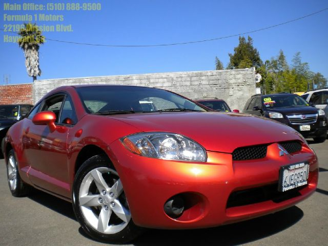 2007 MITSUBISHI ECLIPSE orange automatic transmission 2 door power windows air conditioning dual c